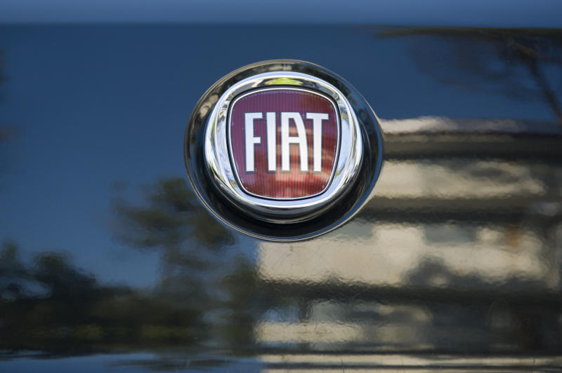 """""""Padua, Italy - July 9, 2011: Fiat metallic logo on a car rear hood. Fiat Automobiles S.P.A. is an Italian automaker which produces Fiat branded cars since 1899. Shot in a public parking."""""""