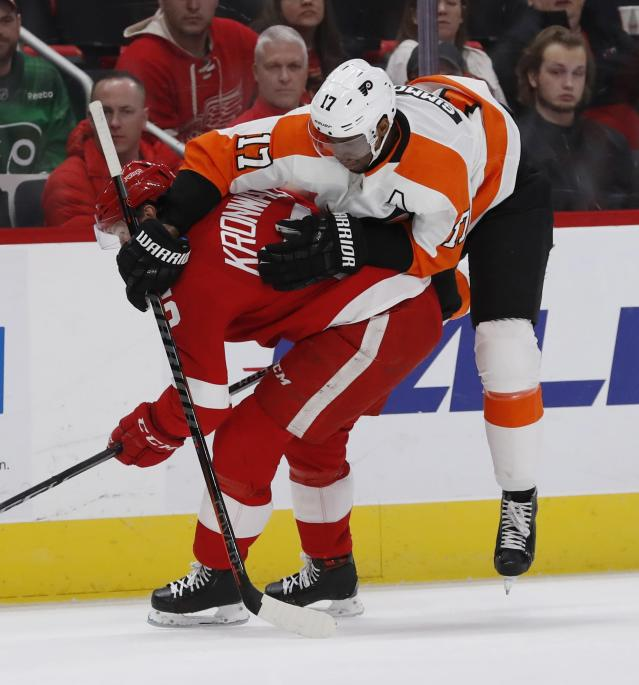 Philadelphia Flyers right wing Wayne Simmonds (17) runs into Detroit Red Wings defenseman Niklas Kronwall (55) during the first period of an NHL hockey game, Sunday, Feb. 17, 2019, in Detroit. (AP Photo/Carlos Osorio)