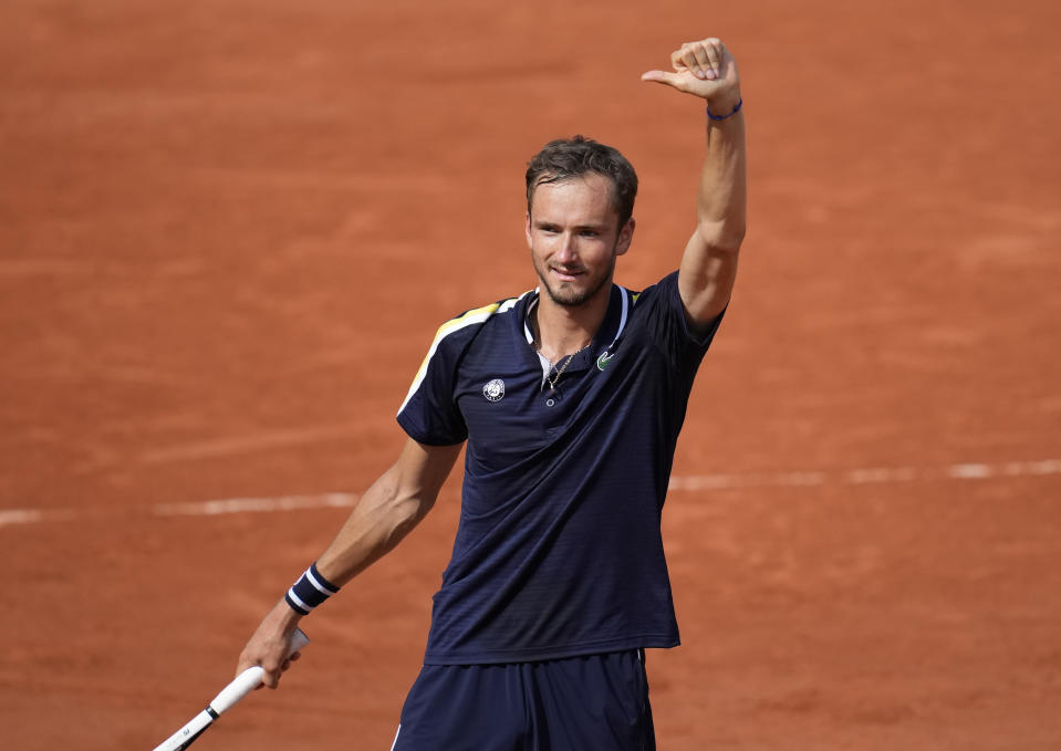 Russia's Daniil Medvedev celebrates after defeating Chile's Cristian Garin during their fourth round match on day 8, of the French Open tennis tournament at Roland Garros in Paris, France, Sunday, June 6, 2021. (AP Photo/Christophe Ena)