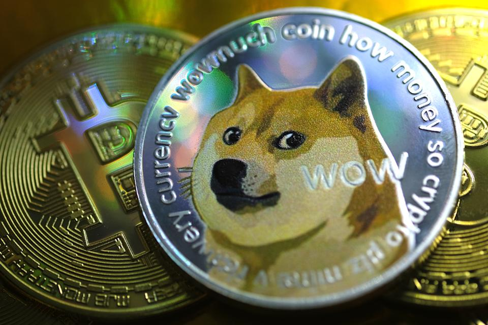 KATWIJK, NETHERLANDS - JANUARY 29: In this photo illustration visual representations of digital cryptocurrencies, Dogecoin and Bitcoin, are displayed on January 29, 2021 in Katwijk, Netherlands.  (Photo by Yuriko Nakao/Getty Images)
