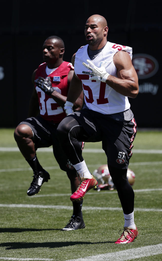 San Francisco 49ers linebacker Michael Wihoite (57) warms up next to teammate Kendall Hunter (32) during an NFL football training camp on Friday, July 25, 2014, in Santa Clara, Calif. (AP Photo)