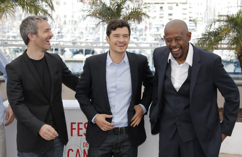 From left, director Jerome Salle, actors Orlando Bloom and Forest Whitaker pose for photographers during a photo call for the film Zulu at the 66th international film festival, in Cannes, southern France, Sunday, May 26, 2013. (AP Photo/Lionel Cironneau)
