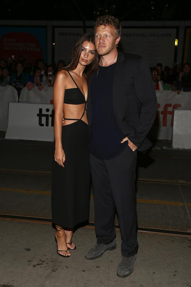 <p>Emrata attended the <b>Uncut Gems</b> premiere with her hubby Sebastian in a cutout dress too sexy for words. She finished it off with strappy Steve Madden shoes.</p>