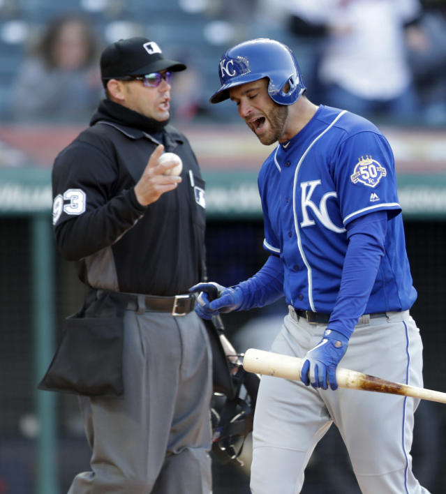 Kansas City Royals' Drew Butera, right, reacts after striking out against Cleveland Indians starting pitcher Trevor Bauer in the fifth inning of a baseball game, Saturday, April 7, 2018, in Cleveland. Home plate umpire Will Little makes the call. (AP Photo/Tony Dejak)