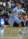 Columbia's Maodo Lo (12) dribbles during an NCAA college basketball game against Connecticut in Bridgeport, Conn., Monday, Dec. 22, 2014. Lo scored a game-high 24 points in Columbia's 80-65 loss. (AP Photo/Fred Beckham)