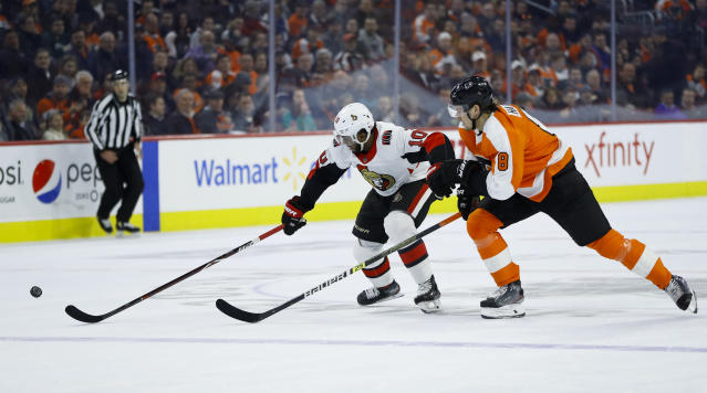 Ottawa Senators' Anthony Duclair, left, and Philadelphia Flyers' Robert Hagg chase after the puck during the first period of an NHL hockey game, Monday, March 11, 2019, in Philadelphia. (AP Photo/Matt Slocum)