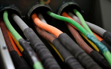 FILE PHOTO: Fiber optic cables carrying internet providers are seen running into a server room at Intergate.Manhattan, a data center owned and developed by Sabey Data Center Properties, during a tour of the facility in lower Manhattan, in New York, March 20, 2013. REUTERS/Mike Segar/File Photo