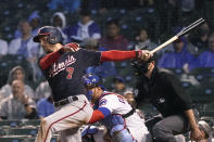 Washington Nationals' Trea Turner watches his RBI single off Chicago Cubs starting pitcher Zach Davies during the fifth inning of a baseball game Tuesday, May 18, 2021, in Chicago. (AP Photo/Charles Rex Arbogast)