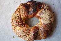 "Whether or not you plan to observe Yom Kippur, spending a few hours this weekend tending and shaping this seed-crusted loaf is a very good idea. <a href=""https://www.epicurious.com/recipes/food/views/challah-bread?mbid=synd_yahoo_rss"" rel=""nofollow noopener"" target=""_blank"" data-ylk=""slk:See recipe."" class=""link rapid-noclick-resp"">See recipe.</a>"