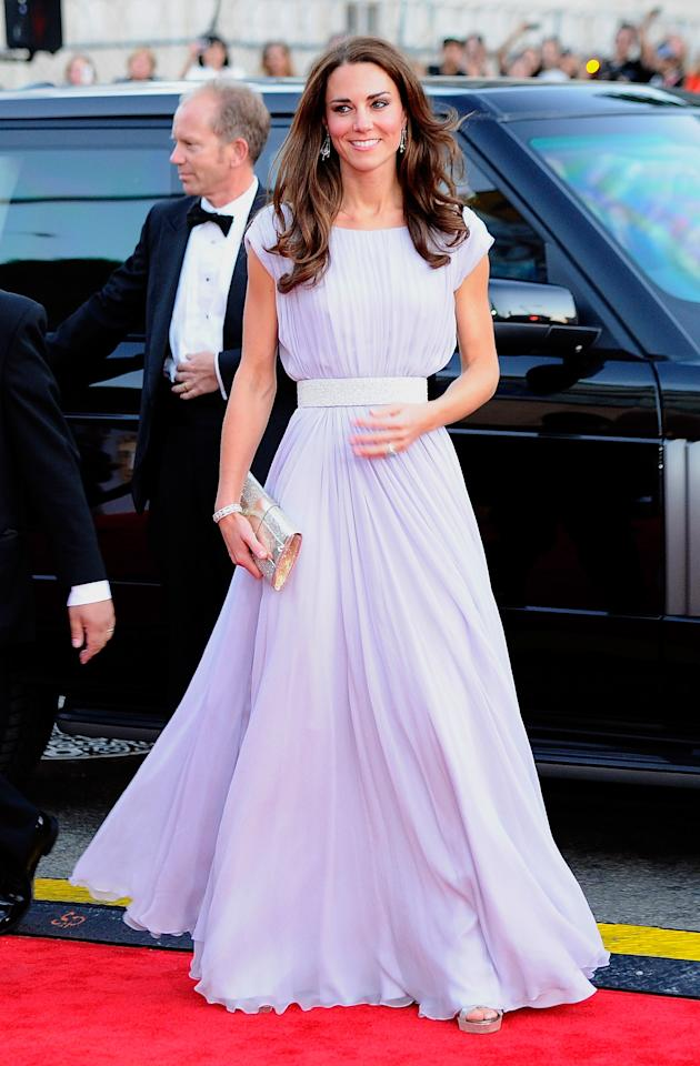 <p>Just three months after tying the knot, the Duchess of Cambridge demonstrated her newfound royal wardrobe at the BAFTA Brits to Watch event. For the red carpet, she chose a bespoke Alexander McQueen dress finished with a glitzy £110 Jimmy Choo clutch and £135 shoes – also by the brand. <em>[Photo: Getty]</em> </p>