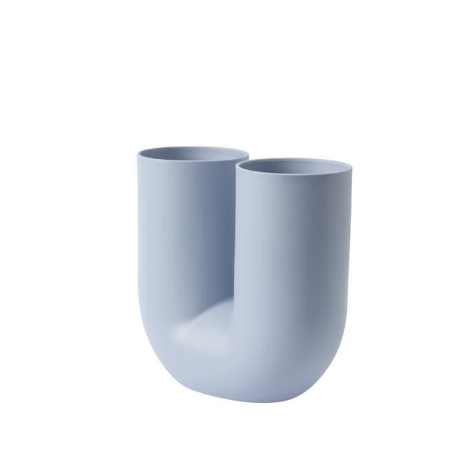 """<br><br><strong>Muuto</strong> Light Blue Kink Vase, $, available at <a href=""""https://go.skimresources.com/?id=30283X879131&url=https%3A%2F%2Ffave.co%2F3ma45A8"""" rel=""""nofollow noopener"""" target=""""_blank"""" data-ylk=""""slk:Trouva"""" class=""""link rapid-noclick-resp"""">Trouva</a>"""