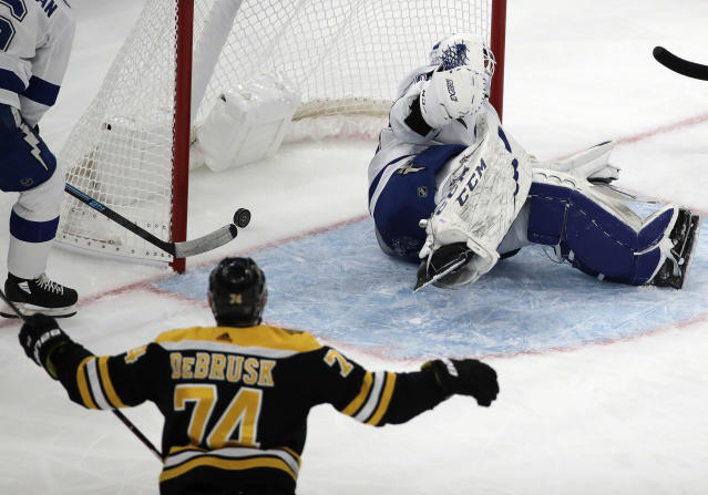 Boston Bruins left wing Jake DeBrusk (74) watches his shot go in for a goal against Tampa Bay Lightning goaltender Louis Domingue (70) in the second period of an NHL hockey game, Thursday, Feb. 28, 2019, in Boston. (AP Photo/Elise Amendola)