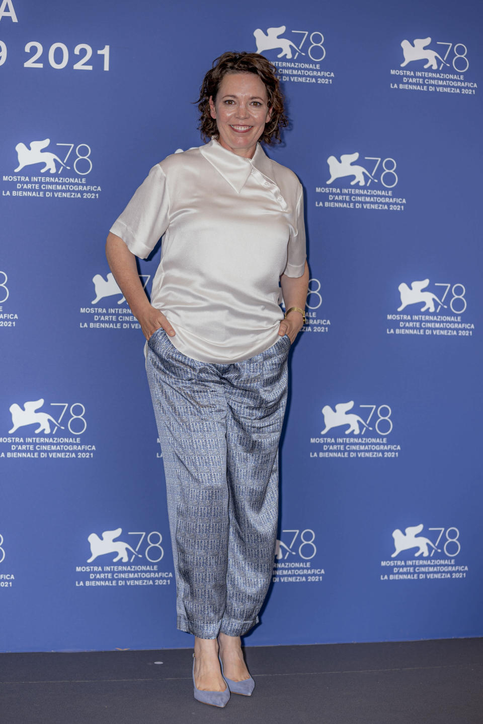 Olivia Colman poses for photographers at the photo call for the film 'XThe Lost Daughter' during the 78th edition of the Venice Film Festival in Venice, Italy, Friday, Sep, 3, 2021. (AP Photo/Domenico Stinellis)