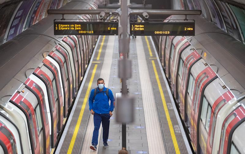 A commuter wearing a protective face mask at Clapham Common underground station, London, as train services increase this week as part of the easing of coronavirus lockdown restrictions. (Photo by Dominic Lipinski/PA Images via Getty Images)