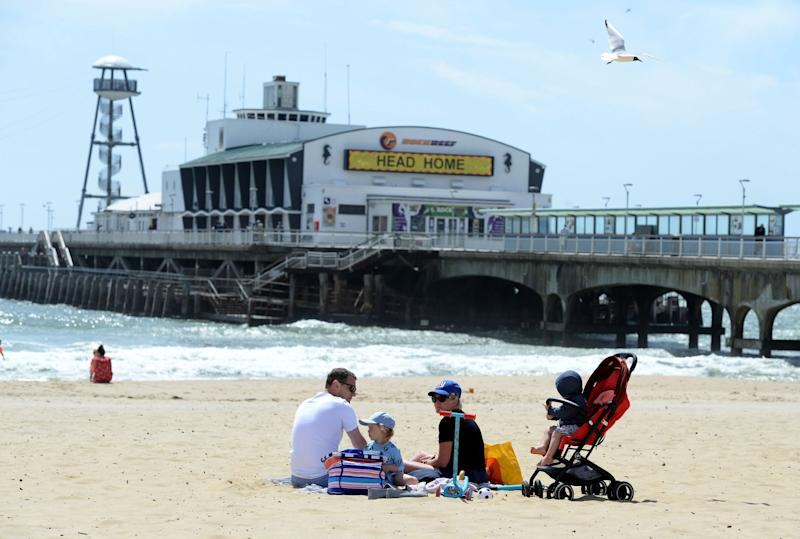 A family making the most of the sunshine in Bournemouth (Getty Images)