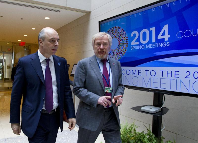 Russian Finance Minister Anton Siluanov, left, and Russian Deputy Finance Minister Sergei Storchak walk to the G20 finance ministers and central bank governors meeting on the sidelines of their meeting at World Bank Group-International Monetary Fund Spring Meetings in Washington, Friday, April 11, 2014. ( AP Photo/Jose Luis Magana)