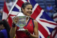 Emma Raducanu, of Britain, holds up the US Open championship trophy after defeating Leylah Fernandez, of Canada, during the women's singles final of the US Open tennis championships, Saturday, Sept. 11, 2021, in New York. (AP Photo/Elise Amendola)
