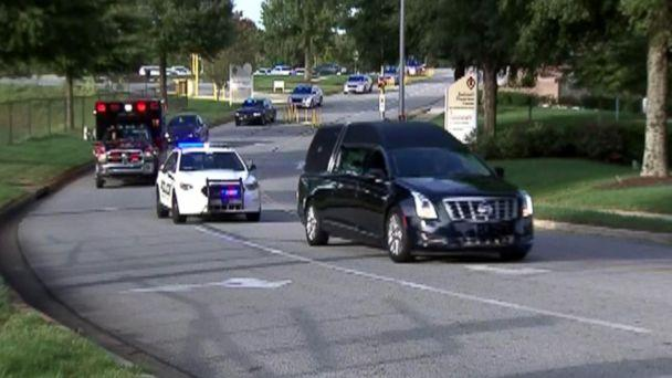 PHOTO: Gwinnett County, Georgia, police and paramedics escort a hearse carrying the body of Officer Antwan Toney from a hospital where he died from a gunshot wound to the Gwinnett County Medical Examiner's office on Oct. 20, 2018. (WSB-TV)
