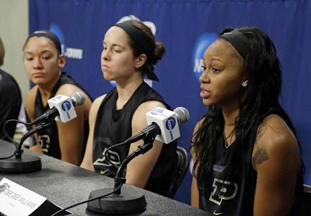 Purdue guard Dee Dee Williams, right, answers a question as teammates Courtney Moses, center, and Whitney Bays sit near during an NCAA women's college basketball tournament news conference in West Lafayette, Ind., Sunday, March 23, 2014. Purdue faces Oklahoma State in a second round game on Monday. (AP Photo/Michael Conroy)