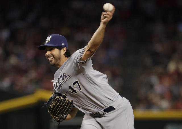 Milwaukee Brewers starting pitcher Gio Gonzalez throws during the first inning of a baseball game against the Arizona Diamondbacks, Saturday, July 20, 2019, in Phoenix. (AP Photo/Matt York)