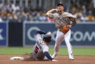San Diego Padres shortstop Ha-Seong Kim, right, prepares to throw to first to complete a double play after forcing out Atlanta Braves' Freddie Freeman, left, at second base on a ball hit by Ozzie Albies during the first inning of a baseball game Sunday, Sept. 26, 2021, in San Diego. (AP Photo/Derrick Tuskan)