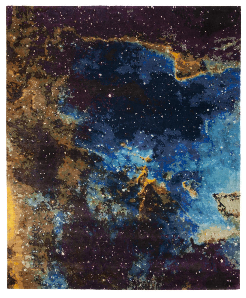 This image provided by Jan Kath Design GmbH shows an outer space themed rug. German designer Jan Kath has created a rug collection called Spacecrafted inspired by imagery of gas clouds and asteroid nebulae from the Hubble telescope. (Dimo Feldmann/Jan Kath Design GmbH via AP)