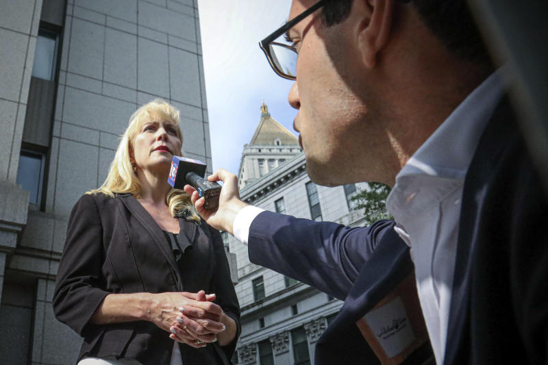 Sigrid McCawley, attorney for alleged sexual abuse victims of financier Jeffrey Epstein who committed suicide while awaiting trial, addresses the media after a hearing in Manhattan Federal Court to discuss plans for unsealing more court records for a civil case against Epstein, Wednesday Sept. 4, 2019, in New York. (AP Photo/Bebeto Matthews)
