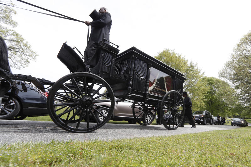 The casket of The Rev. Joseph E. Lowery is moved to graveside by horse and carriage at the Westview cemetery, Saturday, April 4, 2020, in Atlanta. For more than four decades after the death of his friend and civil rights icon, the Rev. Martin Luther King Jr., the fiery Alabama preacher was on the front line of the battle for equality, with an unforgettable delivery that rivaled King's — and was often more unpredictable. (AP Photo/John Bazemore, Pool)