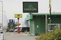 This May 27, 2021, shows a marijuana retail store down the block from the Open Door Baptist Church , located inside a former strip club in Anchorage, Alaska. Pastor Kenny Menendez hopes that the church — which is also situated between a sex store and downtrodden motels — could be a start to improving the neighborhood. (AP Photo/Mark Thiessen)