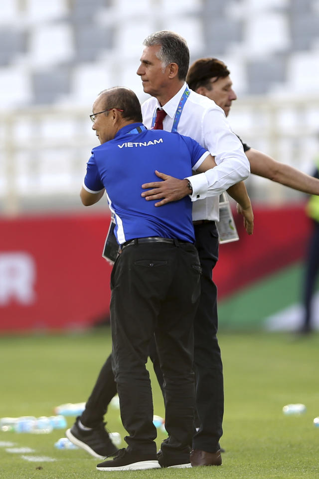 Iran's head coach Carlos Queiroz, right, greets Vietnam's head coach Park hang-Seo during the AFC Asian Cup group D soccer match between Iran and Vietnam at Al Nahyan Stadium in Abu Dhabi, United Arab Emirates, Saturday, Jan. 12, 2019. (AP Photo/Kamran Jebreili)