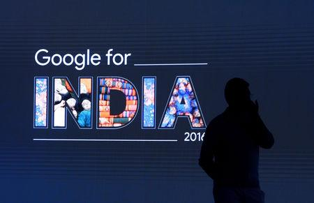 FILE PHOTO: Man stands in front of a screen during a Google event in New Delhi