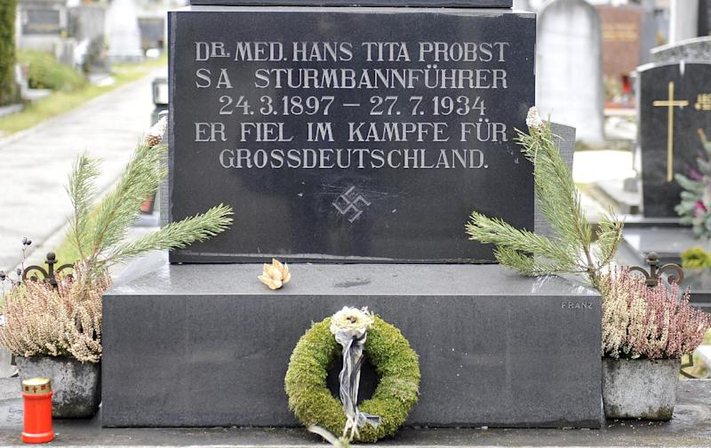 "This picture taken Tuesday, Jan. 21, 2014 shows a marble tombstone which is adorned by a swastika and the inscription ""He died in the struggle for a Great Germany"" at the central cemetery in Graz, Austria. Austrian law bans such symbols, and those displaying them face criminal charges and potential prison terms. Yet the emblems reflecting this country's darkest chapter in history endure here, and officials here appear either unable or unwilling to do away with them. (AP Photo/Hans Punz)"