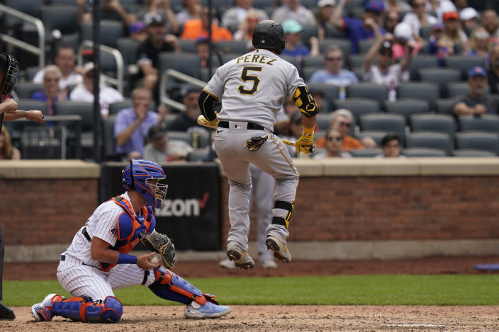 Pittsburgh Pirates' Michael Perez (5) reacts after striking out looking during the eighth inning of a baseball game against the New York Mets at Citi Field, Sunday, July 11, 2021, in New York. (AP Photo/Seth Wenig)