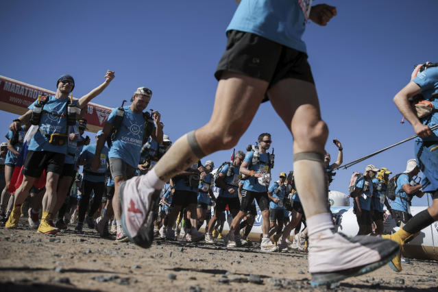 Competitors take off at the starting point of a new stage in the 33rd edition of Marathon des Sables, in the Sahara desert, near Merzouga, southern Morocco, Saturday, April 14, 2018. (AP Photo/Mosa'ab Elshamy)