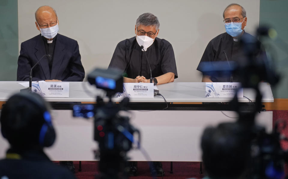 From left, Cardinal John Tong Hon, Stephen Chow Sau-yan, and Bishop Joseph Ha Chi-Shing, OFM Auxiliary Bishop of Hong Kong, attend a press conference in Hong Kong Tuesday, May 18, 2021. Pope Francis on Monday named a new bishop for Hong Kong, tapping the head of his own Jesuit order in the region, the Rev. P. Stephen Chow Sau-Yan, for the politically sensitive position that has been vacant for two years. (AP Photo/Vincent Yu)