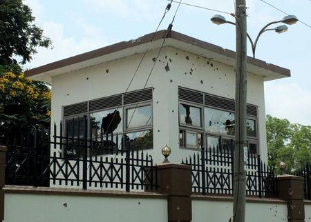 Bullet holes are seen on the security tower following fighting outside the Presidential State House in South Sudan's capital Juba, July 14, 2016. REUTERS/Stringer