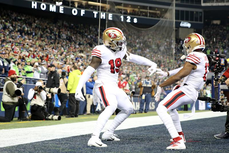Wide receiver Deebo Samuel (19) of the San Francisco 49ers celebrates his touchdown with Emmanuel Sanders. (Photo by Abbie Parr/Getty Images)