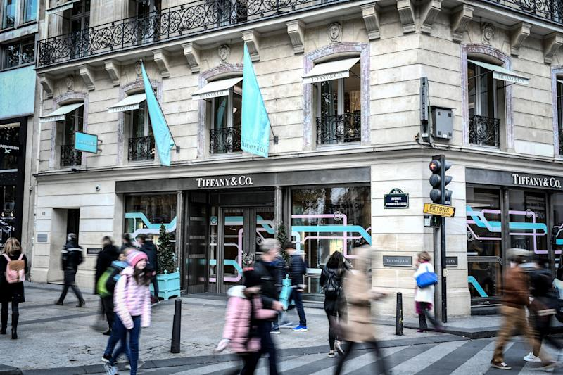 People walk past the US luxury shop Tiffany&Co.'s in Paris on October 29, 2019. - French luxury giant LVMH said on October 28, 2019 it was exploring a takeover of US jewellers Tiffany, most famous for its fine diamonds and luxury wedding and engagement rings. (Photo by STEPHANE DE SAKUTIN / AFP) (Photo by STEPHANE DE SAKUTIN/AFP via Getty Images)