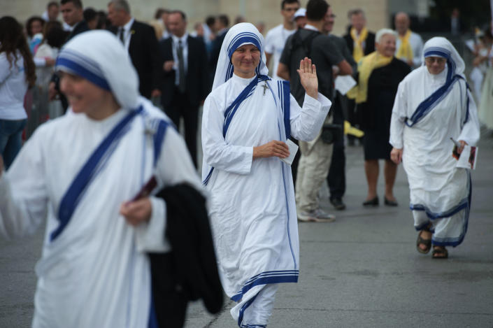 Nuns arrive to attend the Holy Mass to be celebrated by Pope Francis in Tirana on September 21, 2014 (AFP Photo/Armend Nimani)