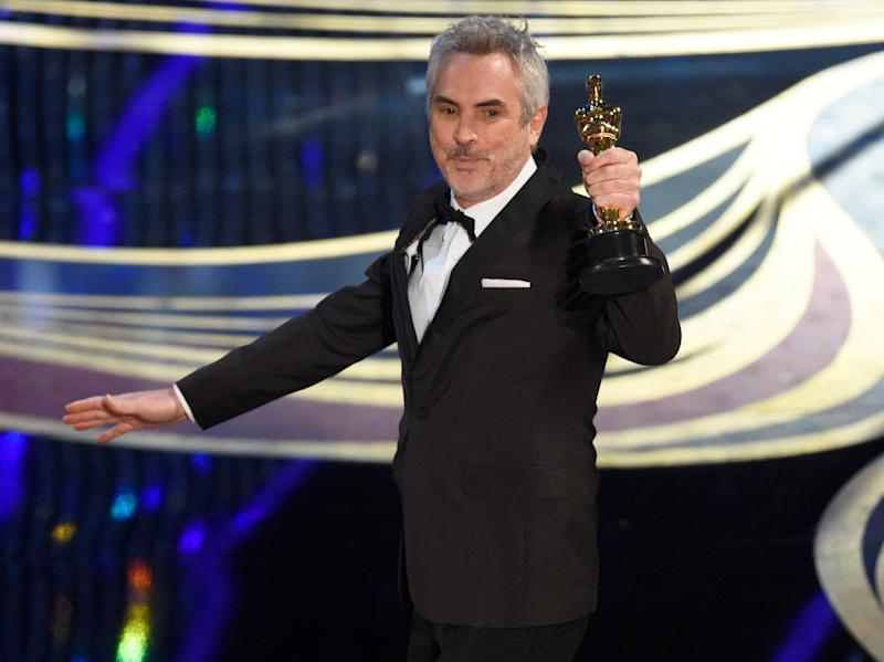 "Alfonso Cuaron accepts the award for best cinematography for ""Roma"" at the Oscars on Sunday, Feb. 24, 2019, at the Dolby Theatre in Los Angeles. (Photo by Chris Pizzello/Invision/AP)"