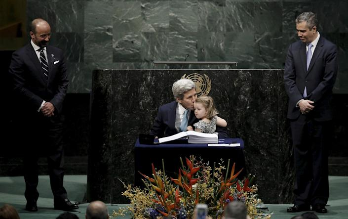 Image: Secretary of State John Kerry kisses his two-year-old granddaughter after signing the Paris Agreement on climate change at United Nations.  (Mike Segar / Reuters)