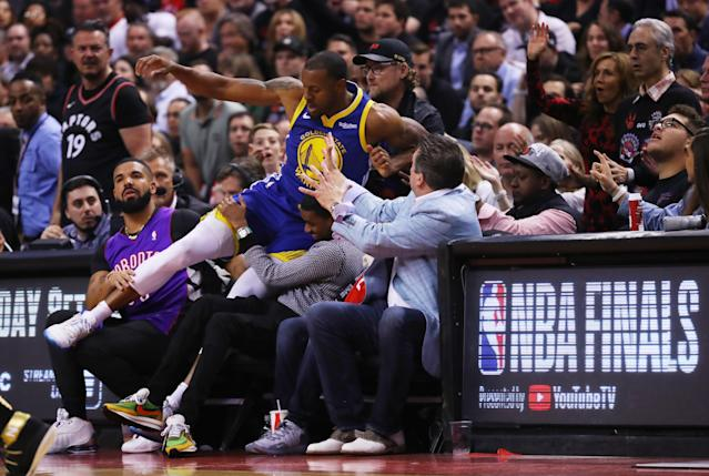 Draymond Green #23 of the Golden State Warriors dives into the crowd against the Toronto Raptors in the second quarter during Game One of the 2019 NBA Finals at Scotiabank Arena on May 30, 2019 in Toronto, Canada. (Photo by Gregory Shamus/Getty Images)