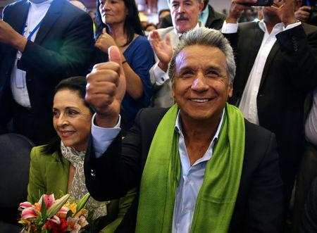 Ecuadorean presidential candidate Lenin Moreno gives a thumb up while waiting for the results of the national election in a hotel, in Quito