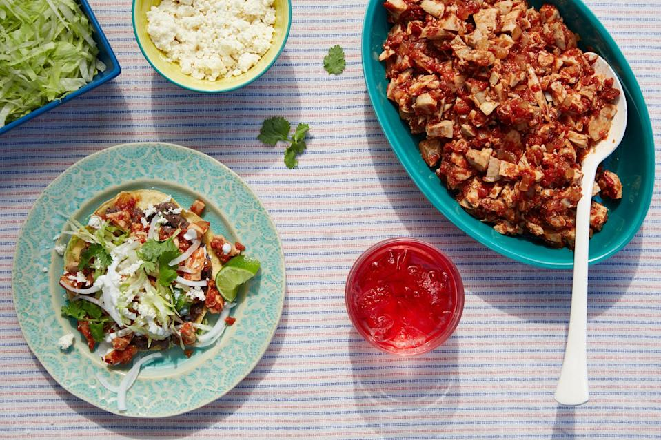 """This tinga-inspired tostada topping is bolstered by the addition of crispy crumbled Mexican chorizo. Chicken thighs never had it so good. <a href=""""https://www.epicurious.com/recipes/food/views/spicy-chipotle-chicken-tostadas-56389833?mbid=synd_yahoo_rss"""" rel=""""nofollow noopener"""" target=""""_blank"""" data-ylk=""""slk:See recipe."""" class=""""link rapid-noclick-resp"""">See recipe.</a>"""