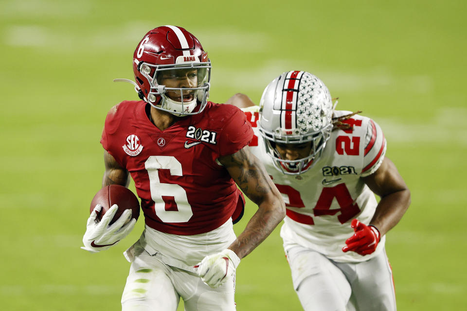 Alabama Crimson Tide WR DeVonta Smith runs ahead of Ohio State's Josh Proctor during a College Football Playoff title game on Jan. 11.  (Sam Greenwood/Getty Images)