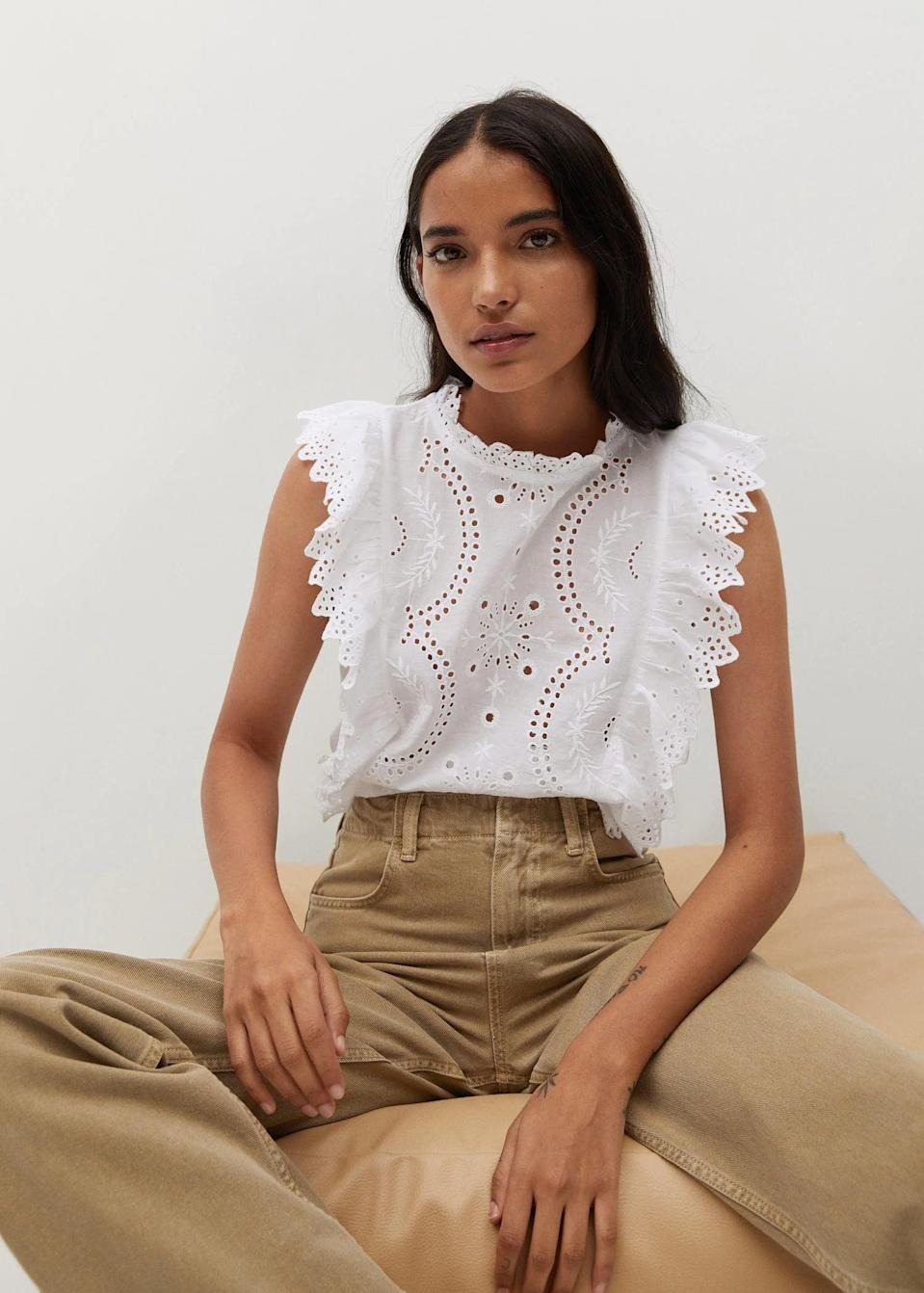 <p>This embellished <span>Mango Openwork Cotton Top</span> ($50) will look great with your favorite jeans and a pair of mules.</p>