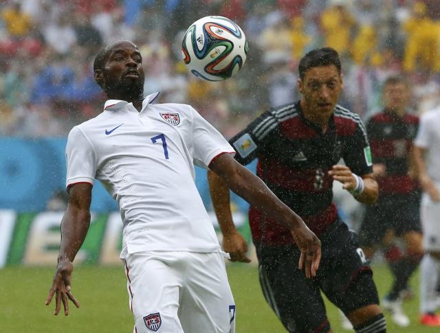 DaMarcus Beasley of the U.S. (L) fights for the ball with Germany's Mesut Ozil during their 2014 World Cup Group G soccer match at the Pernambuco arena in Recife June 26, 2014. REUTERS/Tony Gentile (BRAZIL - Tags: SOCCER SPORT WORLD CUP)