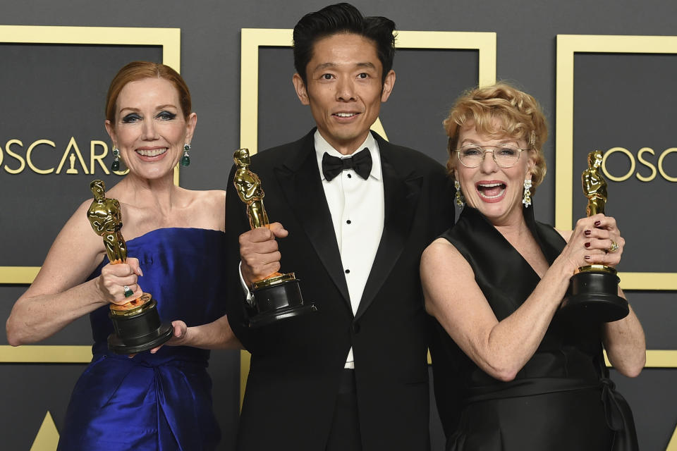"""Anne Morgan, from left, Kazu Hiro, and Vivian Baker, winners of the award for best makeup and hairstyling for """"Bombshell"""", pose in the press room at the Oscars on Sunday, Feb. 9, 2020, at the Dolby Theatre in Los Angeles. (Photo by Jordan Strauss/Invision/AP)"""