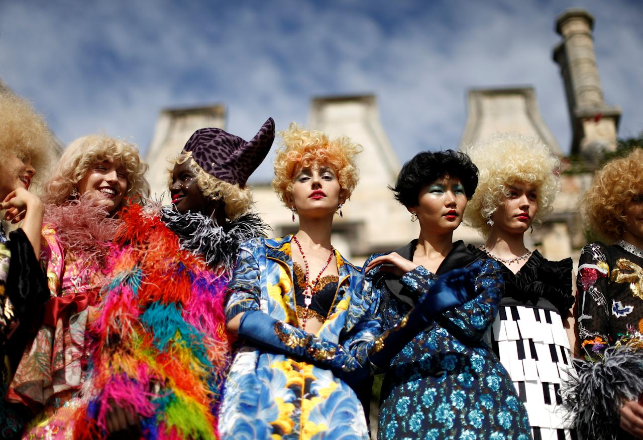 Models pose against the backdrop of an old sandstone chapel during a fashion show for the label Romance Was Born on the waterfront of Sydney Harbour during Australian Fashion Week, Sydney, Australia May 18, 2016. REUTERS/Jason Reed     TPX IMAGES OF THE DAY