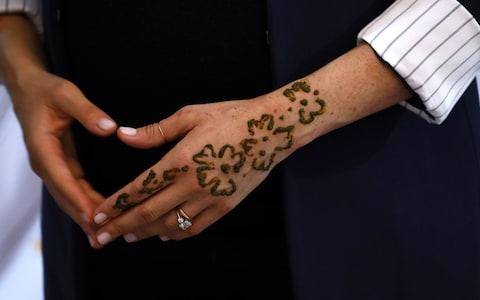 The henna tattoo, intended to celebrate Meghan's pregnancy - Credit: Getty